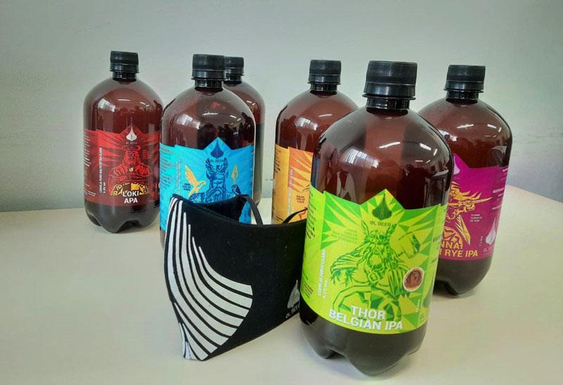 novos rótulos de growlers da cervejaria artesanal OL Beer e máscara colecionável exclusiva da marca